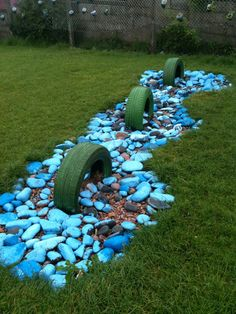 Tire and stone outdoor art (loch ness monster)