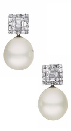 A Pair of Diamond and Cultured Pearl Ear Pendants: Each designed as a square plaque set with baguette and circular-cut diamonds, suspending a detachable South Sea cultured pearl drop measuring approximately 17.00 mm, mounted in 18K white gold, length 1.25 inches. Via Philips.