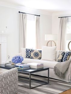 Eclectic patterns make a pretty statement in this living room designed by Lillian August. #luxeNYC