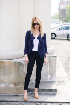Spring outfit idea with a blue jacket, black jeans, and nude heels
