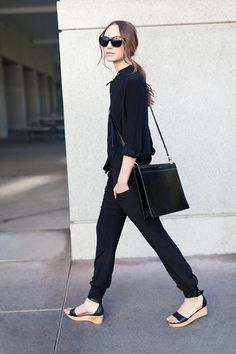 Simply irresistible in all black and flatforms.