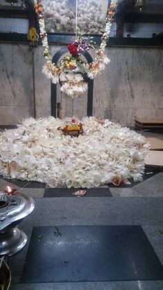 "kailasanath: "" Shivalinga bedecked with white blossoms Local temple in Western Maharashtra """
