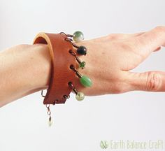 Forest Dew Bracelet - A chunky tan leather cuff unisex bracelet with dangling woodland stone droplets and a brass clasp. By Earth Balance Craft.