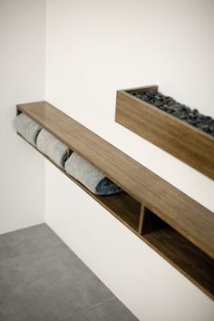 http://www.bkgfactory.com/category/Bath-Towels/ Shelf like this by bath, near floor, wider on bottom for access???