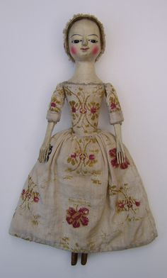 Dressed in an amazing rare piece of early linen with hand done wool work.       Sold