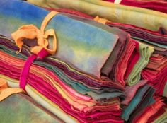 This unique (off the bolt) wool was dyed via the Transitional Dyeing process, which--like marbleized wool--is a simple process requiring no dye.