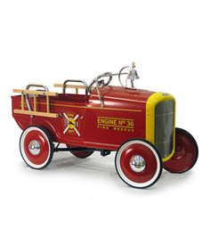 We'll take a modern firetruck when we need it in real life, but this awesome, classic toy truck belongs at the top of the toy-box! (And did you notice the bell? So cool.)