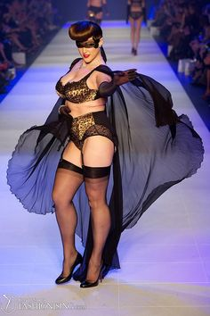 You can see all of the Von Follies by Dita Von Teese autumn / winter 2012 runway collection by clicking on a thumbnail on the left. From there you can browse through each of the pictures from the fashion show.