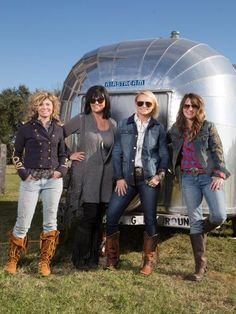 """Miranda called on the Junk Gypsies for help with a surprise makeover for her mom's vintage Airstream. Together, the three """"gypsified"""" the camper using colorful décor and fresh white paint."""