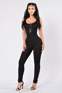 - Available in Black - Lace Up Front - Spaghetti Straps - Skinny Leg - Polyester/Rayon Blend