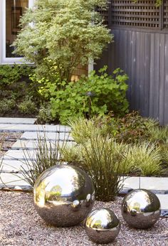 Shiny garden ornaments. Your greenery may die back in the winter months, but garden ornaments will shine on. Choose something with a bit of gleam, like the silver orbs shown here, for maximum impact.