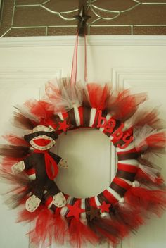 adorable sock monkey wreath....bet my sister could make me a red one that I could leave up for February and then change the decorations for both parties;)??!