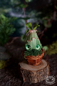 This is completely handmade cute fantasy Sprout creature made by polymer clay. His eye are glass. It is painted with acrylics and dry pastel. It fixed with matte varnish. Size with leaves 6 cm.  This is a one of a kind handmade artist doll. It is not made for children and it requires carefull handling. Also as a handmade work it may have some imperfections.  In a set: sprout and basket (or pot)  Please note: scenery things on a photo are not included. Only toy on sale.  I ship with tracking…
