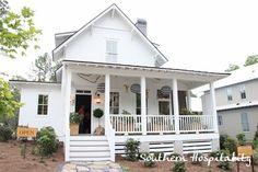 Black & white paper lanterns on porch. Ballard Designs Serenbe house