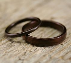 wooden wedding bands from stout woodworks. #wooden #rings #wedding.  these are kinda neat. original.