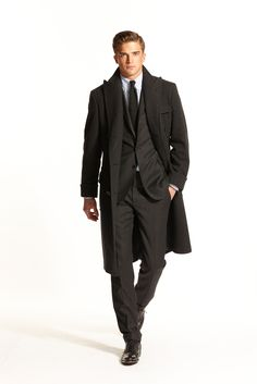 Here is an example of a polo coat. It ends just below the knee and probably has a half-belt in the back.