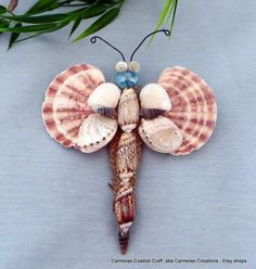 here is a unique shell butterfly ornament ready to fly into your home. He is made with a teal glass cabochon head, wire antennae, olive sea Butterfly Ornaments, Seashell Ornaments, Butterfly Wall Decor, Seashell Art, Seashell Crafts, Shell Animals, Seashell Projects, Driftwood Projects, Shell Flowers