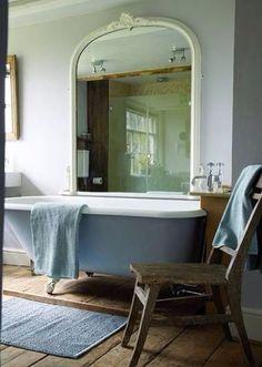 Vintage tub and huge mirror