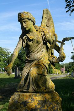 weathered angel statue memorial by Daves Portfolio
