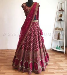 Beautiful wine color designer blouse and lehenag with net duapatta. 07 October 2017