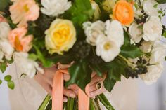 Pretty blooms tied with a coral-colored ribbon | Photo by Rebecca Wood | Floral design by Sweet Woodruff