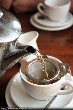 Earl Grey Tea. Bollocks! That tea strainer is just lovely.
