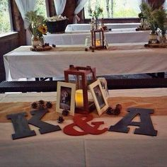 Lanterns,white table cloths with burlap runners and mason jars full of babies breath and sunflowers and orange roses...