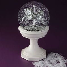 Water Snow Globe With Sliver Carousel Horse - Blower Circulates Snow Inside of Globe - Lights Up Costco http://www.amazon.com/dp/B00EUMJQPO/ref=cm_sw_r_pi_dp_fPfKtb1RR9RD4PNW