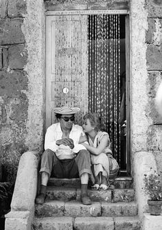 Federico Fellini and Giulietta Masina on the set of Le Notti di Cabiria, 1957