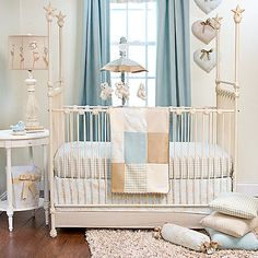 This crib collection features a tailored style and soothing pastel colors making it perfect for your little ones nursery. It mixes blue, cream and tan with woven gingham, 100% cotton houndstooth check, embroidery, velvet and 100% cotton toile.