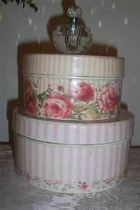 shabby chic...these look like tin boxes, but you could look around for hat boxes and cover them with vintage wall paper.  Wall paper stores will probably give you some sample books.  Cut these up.