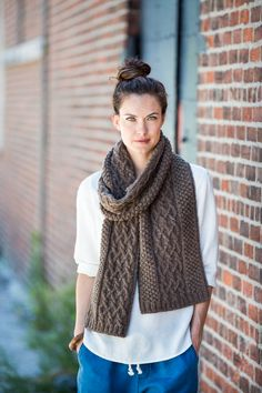Cozy enough for working on the water or just for fending off the elements on a blustery day, this generous scarf is plush with panels of trinity stitch and interlacing cables.