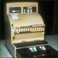 old cash register. We had one of these. I threw it at my sister b/c she made me mad and bike her foot (I was little).