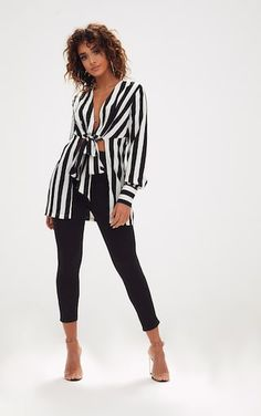 Monochrome Stripe Tie Front Long BlouseAdd this blouse to any outfit for a luxe touch. In a monoc...