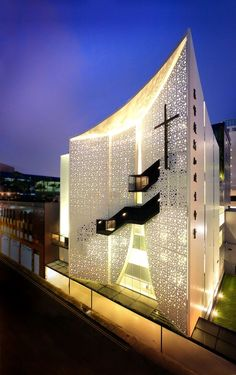 Singapore Life Church by Laud Architects  The bright façade creates an elaborate lit backdrop that emphasizes the dark staircase and feature Cross which makes it stand out ..beautiful