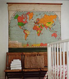 I love using old but colorful maps as decor.  We have a collection of framed maps above our kitchen table, and I made something similar for my nephew's nursery recently.  Now, for some ideas of how to use maps in our wedding invitations...