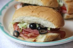 Perfect minis for a party, these sandwiches are layered with provolone cheese, black forest ham, salami and your choice of Italian cold cuts, such as hot capolcolo or mortadella, dressed with creamy Italian dressing, lettuce, tomatoes and olives, if you like.