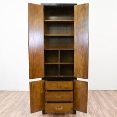 """This pair of """"Century"""" asian inspired armoires are featured in a solid wood with a glossy burl wood front and black lacquer trim. These tall skinny wardrobes are in great condition with 3 drawers, shelf space and gold hardware. Unique storage pieces! #asian #dressers #armoireorwardrobe #sandiegovintage #vintagefurniture"""