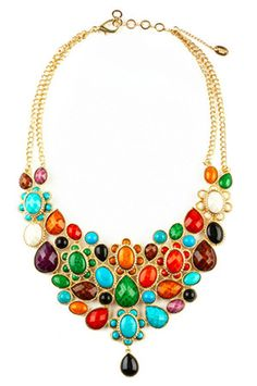 The colors are bonkers, but the silhouette is neat!  The South Fork Hamptons Necklace by Amrita Singh at CoutureCandy.com