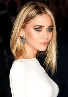 ashley olsen: asymetrical cut with jagged edges, matte brown smokey eye, white straight neck dress by AislingH