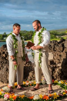Ceremonial leis, island flowers and all the beauty that Maui has to offer. Could Ryan and Tyler's intimate Hawaiian wedding be anymore unreal? {Mariah Milan} | beach wedding | Hawaii wedding|  | same sex marriage | gay wedding | summer wedding | two grooms wedding