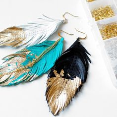 Gold dipped leather feather earrings are tough and sweet. Could use these instead of tassels on curtain tiebacks Feather Jewelry, Feather Earrings, Diy Earrings, Diy Jewelry, Jewelery, Handmade Jewelry, Jewelry Design, Jewelry Making, Gold Earrings