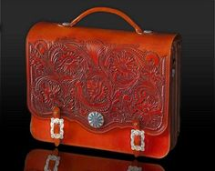I have a similar tooled leather briefcase, I brought back from Texas.  Very pretty.