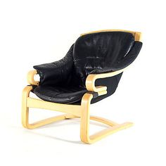Danish chair from the 1970's looks to be laminated rather than bentwood, and a precursor to the popular Ikea Poang chair