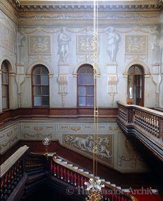 Houghton Hall ~ The walls of the Grand Staircase are lined with canvas painted in grisaille by William Kent