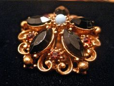 Ebony Gold Artist Clip Earrings. $15.00, via Etsy.