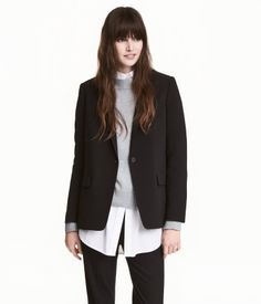 Black. Straight-cut blazer in woven fabric with a button and front pockets with flap. Lined.