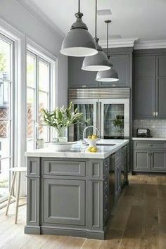 Delicieux Susan Greenleaf San Francisco Home   A Classic Kitchen With French Doors, Gray  Cabinetry, Sub Zero Refrigerators, Pendant Lamps, And A Carrera Oro Marble  ...