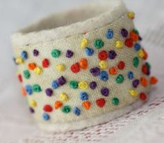 Fabric Textile Ring Confetti Hand Embroidered Ring. $14.00, via Etsy.