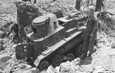 US Marine looking at a knocked-out Japanese Type 94 Te-Ke tankette, Okinawa, Japan, mid-1945
